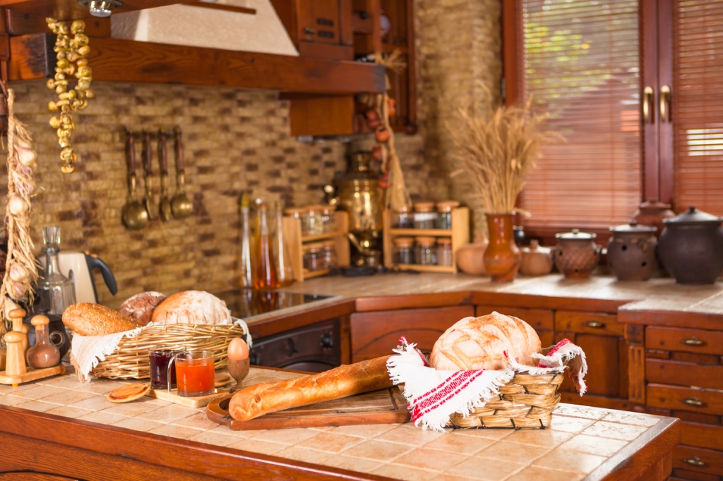 Kitchen with various breads on the counter