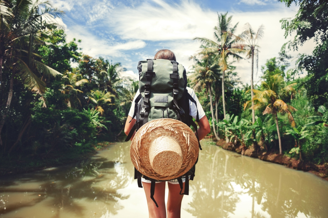 Woman standing near big tropical river
