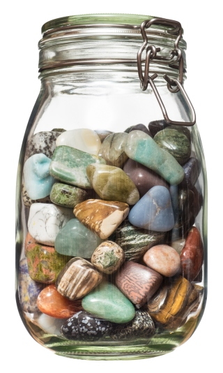 Semiprecious stones canned in glass jar.